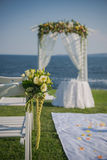 Wedding ceremony flowers, arch, chairs with black sea in the background. Beach wedding Royalty Free Stock Photos