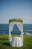 Wedding ceremony flowers, arch, chairs with black sea in the background. Beach wedding. Wedding ceremony flowers, arch, chairs with black sea in the background Royalty Free Stock Image