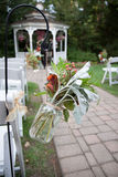 Wedding Ceremony Flowers. Decorations for wedding ceremony, plants in mason jars on hooks Stock Images