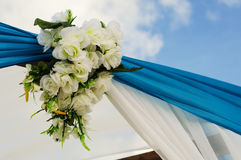 Wedding ceremony flowers. Decorative wedding flowers for an outdoor venue. Blue theme with white flowers Stock Image