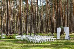 Wedding ceremony in the forest. Beautiful gentle arch.  Stock Photography