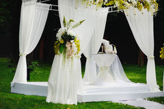 Wedding ceremony. In forest, table with champagne Stock Images