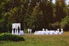 Wedding ceremony in garden. Wedding ceremony in summer garden Stock Photos