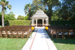 Wedding ceremony in garden. With a kiosk and chairs Royalty Free Stock Photo