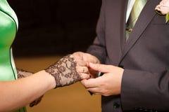 Wedding ceremony. Holding hands newlyweds Royalty Free Stock Photo