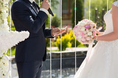 Wedding ceremony in the open air. The groom and the bride blow oaths each other at wedding ceremony Stock Images