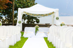 Wedding ceremony outdoor in a beautiful garden Royalty Free Stock Image