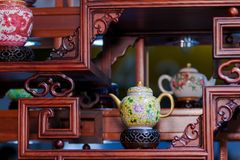 Antique tea sets. At the wedding ceremony, people will put up some dolls that symbolize the bride and groom to celebrate the happiness of the new couple royalty free stock image