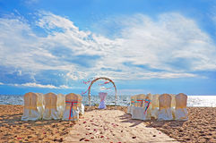 Wedding ceremony place in european style with the arch on the beach. Wedding ceremony place in modern european style with the arch on the beach with nobody Stock Image
