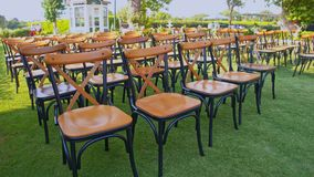 Wedding ceremony place. Is a stock video that displays chairs with flowers on the green grass. Use this clip for wedding supplier ads, presentations, social stock footage