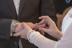 Wedding ceremony - Plugging in the wedding ring Stock Images