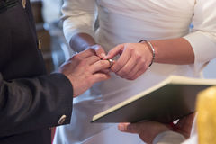 Wedding ceremony - Plugging in the wedding ring Stock Photos