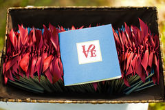 Wedding ceremony programs. In a basket with the word Love on it Stock Photography
