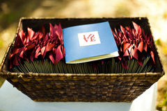 Wedding ceremony programs. In a basket with the word Love featured Royalty Free Stock Photo