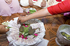 Wedding Ceremony. Relative scattering popped rice and flowers on tray according to tradition Stock Images