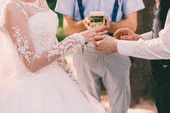 Wedding ceremony with rings on nature. At sunny day Stock Photography