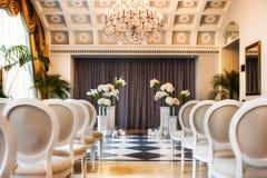 Wedding ceremony set up inside. Royalty Free Stock Photos