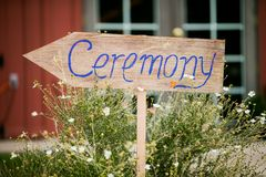 Wedding Ceremony sign. Brown wooden sign at a wedding pointing in the direction of the ceremony Royalty Free Stock Images