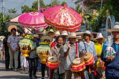 Wedding ceremony on the street. A group of cheerful people playing drums and carrying flowers stock photos