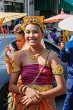 Wedding ceremony on the street. Young attractive Thai women in traditional dresses and jewelery are smiling cute. Ayutthaya, Thailand - March 3, 2018: Wedding royalty free stock image
