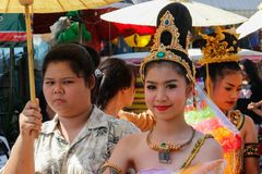 Wedding ceremony on the street. Young attractive Thai women in traditional dresses and jewelry are smiling cute next to an unimpr royalty free stock photos