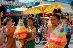 Wedding ceremony on the street. Young attractive women in traditional dresses and jewelery stand under umbrellas and hold bouquets. Ayutthaya, Thailand - March 3 royalty free stock photos