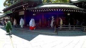 A wedding ceremony taking place in Meiji shrine harajuku. stock footage