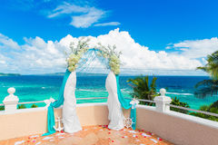Wedding ceremony on a tropical beach in blue. Arch decorated wit Royalty Free Stock Photography