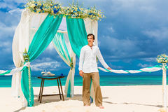 Wedding ceremony on a tropical beach in blue.The groom waits for Stock Photography