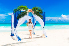 Wedding ceremony on a tropical beach in blue. Happy bride with a Stock Images