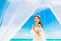 Wedding ceremony on a tropical beach in blue. Happy bride with a Stock Photos