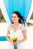 Wedding ceremony on a tropical beach in blue. Happy bride under Royalty Free Stock Photography