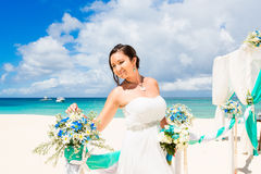 Wedding ceremony on a tropical beach in blue. Happy bride under Royalty Free Stock Images