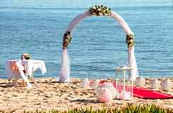 Wedding ceremony on a tropical beach in blue. Royalty Free Stock Photos