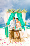 Wedding ceremony on a tropical beach in blue. Sand Ceremony. Hap Stock Photo