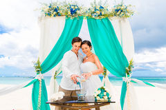 Wedding ceremony on a tropical beach in blue. Sand Ceremony. Hap Stock Images