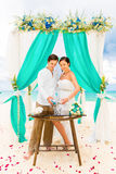 Wedding ceremony on a tropical beach in blue. Sand Ceremony. Hap Royalty Free Stock Photos