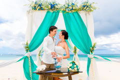 Wedding ceremony on a tropical beach in blue. Sand Ceremony. Hap Royalty Free Stock Photo