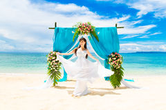 Wedding ceremony on a tropical beach. Happy bride under the wedd Royalty Free Stock Images