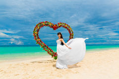 Wedding ceremony on a tropical beach. Happy bride under the wedd Royalty Free Stock Photo