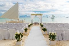 Wedding ceremony on a tropical beach in white. The arch is decor royalty free stock photo