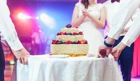 Wedding ceremony. Waiters serving wedding cake Royalty Free Stock Image