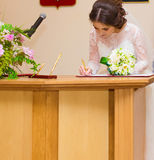 Wedding ceremony. Wedding couple leaving their signatures Royalty Free Stock Image