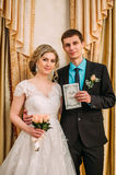 Wedding ceremony. Wedding couple leaving their signatures. ю Royalty Free Stock Photography