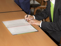 Wedding ceremony. Wedding groom leaving his signature. Groom or business man leaving his signature, in the office Stock Photo