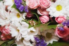 Wedding ceremony, wedding rings. Wedding ceremony wedding rings on flowers selective focus Stock Image