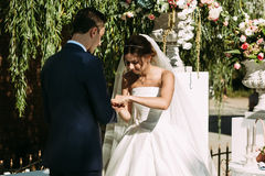 Wedding ceremony of the young couple in the sunny day. A Royalty Free Stock Images