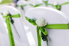 Wedding chair. S with flowers and green ribbon Stock Images