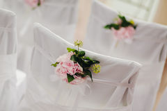Wedding chair cover with pink flowers Royalty Free Stock Image