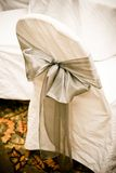 Wedding chair covers. A wedding chair cover with a green sage bow Stock Photo